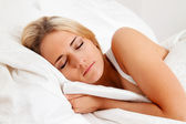 Woman sleeping in bed. — Stock Photo