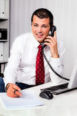 Businessman in office with telephone — Stock Photo