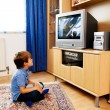 Small children watching television — Stock Photo