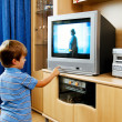 Stock Photo: Small children watching television