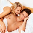 Couple has fun in bed. laughter, joy and eroticism — Stock Photo #10581079