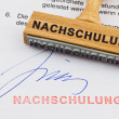 Stock Photo: Wood stamp on document: retraining