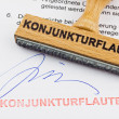Stock Photo: Wood stamp on document: economic downturn