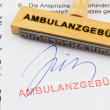 Wood stamp on the document: ambulance fee — Stock Photo