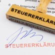 Stock Photo: Wood stamp on document: tax return
