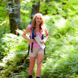 Woman in nature while hiking - Stockfoto