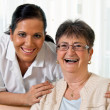 Nurse in aged care for the elderly in altenhei - Stock Photo