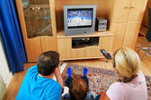 Family watching television — Stock Photo