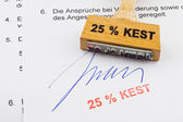 Wood stamp on the document: 25% kest — Stock Photo
