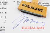 Wood stamp on the document: social services — Stock Photo