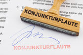 Wood stamp on the document: economic downturn — Stock Photo