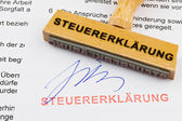 Wood stamp on the document: tax return — Stock Photo