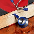 Stock Photo: Stethoscope is medical book