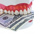 Tooth model with dollar bills — Stock Photo
