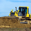 Stock Photo: Excavators at work at construction site