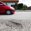 Road with potholes. frost heave - Stok fotoğraf