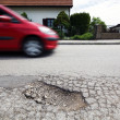 Stock Photo: Road with potholes. frost heave