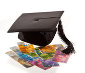 Mortarboard and swiss francs. — Stock Photo