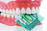 Tooth model with euro notes — Stock Photo