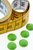 Tape measure and tablets — Stock Photo