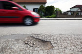 Road with potholes. frost heave — Stok fotoğraf