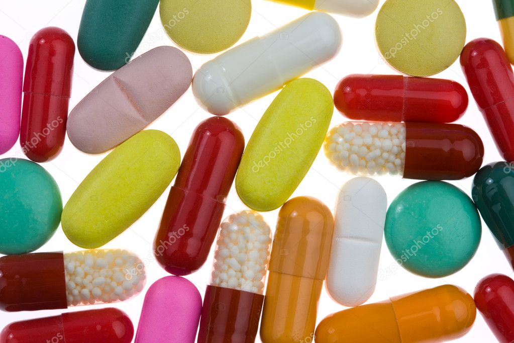 Colorful pills and medicines are located on a white background — Stock Photo #8140383