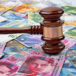 Swiss franc and gavel — Stock Photo