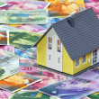 Swiss franc and model house — Stock Photo