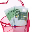 Euro bank notes with heart - Stock Photo
