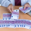 Many euro banknotes - Stock Photo