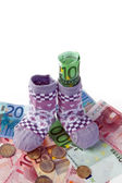 Children's socks and euro banknotes — Stock Photo