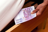 Euro banknotes hidden under bed — Stock Photo