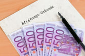 Euro bank notes and certificate of a foundation — Stock Photo