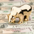 Dollar currency notes with bull and bear - Stock Photo