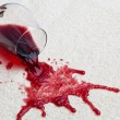 Red wine glass dirty carpet. - ストック写真