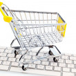 Cart and keyboard. online shopping — Stock Photo