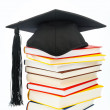 Mortarboard on a book stack - Stok fotoraf