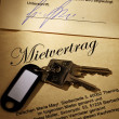 Apartment keys and rental agreement — Stock Photo #8162021
