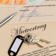 Apartment keys and rental agreement — Stock Photo #8162025