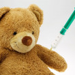 Teddy bear with injection — Stock Photo #8166455