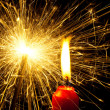 Flame of a candle with a sparkler — Stock Photo