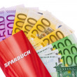 Euro banknotes and savings account — Stock Photo