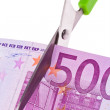 Euro banknotes and scissors - Stock Photo