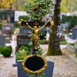 Stone grave in a cemetery - Stock Photo