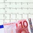 Stock Photo: Ecg curve and ten €