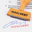 Stock Photo: Wooden stamp on document: insolvent