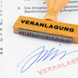 Wooden stamp on the document: assessment - Stock Photo