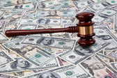 Court hammer and dollar bills — Stock Photo