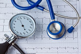Blood pressure measurement and ecg curve — Stock Photo