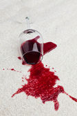 Red wine glass dirty carpet. — Stock Photo
